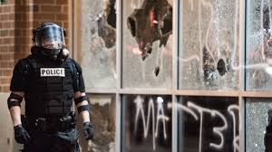 photos pain anger and violence fill streets of charlotte n c