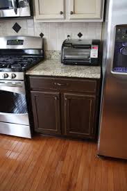 concrete countertops different color kitchen cabinets lighting