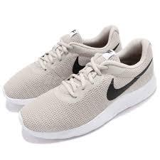 Nike Tanjun Black nike tanjun light bone black white running shoes sneakers