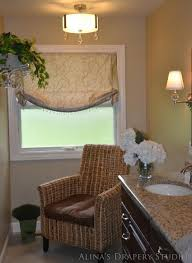 brown valance whtie window frame blind toilet cream wall paint