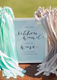 wedding send ideas add a dash of and flair to your exit with ribbon wands waving