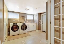 spacius spacious laundry room with tile floor and light grey walls