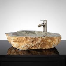 utilizing natural riverstone into a unique bathroom sink