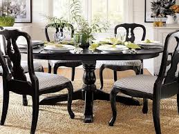 modern round wood dining table dining room modern round wooden dining table with plant on pot