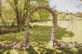 wedding arch log wood branch arch green wedding shoes