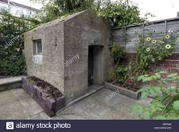 thick concrete air raid shelter in the back garden of a