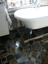 gorgeous shower faucet on brown tile wall in stunning bathroom