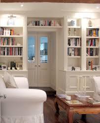 bookshelves around doorway u0026 use small wall around door for books