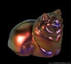 this is the pebble tanuki painted in fancy color shift paint