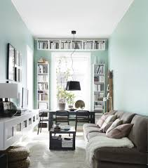 How To Arrange A Long Narrow Living Room by Narrow Living Room With Desk And Bookshelves At The Window