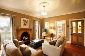 stylish orange paint colors for living rooms with fireplace used