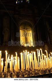 vigil lights catholic church catholic church candles praying stock photos catholic church