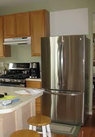 how to build a cabinet around a refrigerator building the refrigerator enclosure remodelando la casa