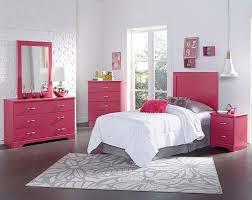pink bedroom for teenage girls blue painting cabinet beside bunk