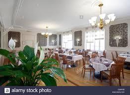 a pot of peace lily in a restaurant dining room france potée de