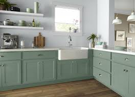 green kitchen cabinets with white countertops 14 kitchen cabinet colors that feel fresh bob vila bob vila