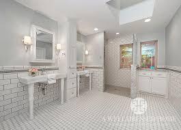 white and gray marble herringbone bathroom shower floor tiles
