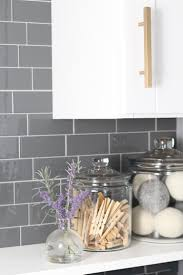laundry room update with peel and stick tile backsplash lydi out
