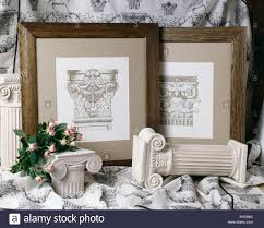 wooden framed neo classical etchings with plaster greek style