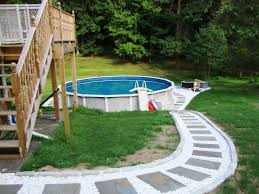 traditional pool backyard ideas with above ground pools deck shed