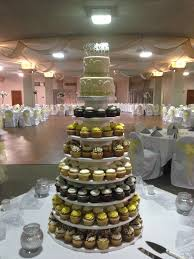 10 tier wedding cupcake tower with 2 tier cake on top thecakebaker