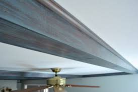 gray washing the ceiling beams in our living room young house love
