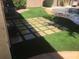 artificial turf gives phoenix backyard a tropical look