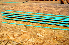 osb particle board engineered wood flooring stacked stock photo