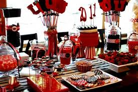 gorgeous graduation party dessert table with a red black and