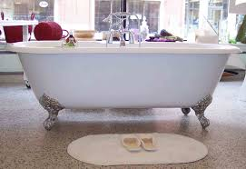 free standing bathtub with claw feet on granite countertop also