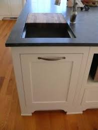 Kitchen Trash Can Ideas 8 Sneaky Ways To Hide An Ugly Trash Can Hidden Kitchen Kitchens