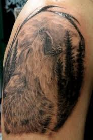 black and grey wolf howling at the moon ink