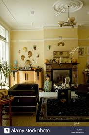 interior of a thirties style living room with a collection of art
