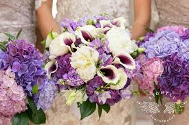 florist fort worth and groom exchange vows during wedding ceremony at
