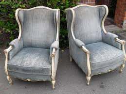 Antique Upholstered Armchairs Pair Of French Cream Painted And Blue Velvet Upholstered Armchairs