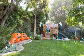 backyard halloween decorations with a cute dragon and a celebrity