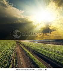 of a country as the sun breaks through the clouds after a