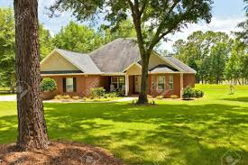 Traditional Style Home Traditional Style Country House With Landscaping In Florida Stock