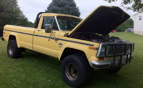 jeep yellow file 1986 jeep j 10 pickup truck yellow 1 jpg wikimedia commons