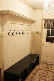adding a coat rack to your wainscoating to look built in itsy