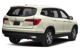 compare honda pilot and ford explorer honda pilot sport utility models price specs reviews cars com
