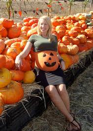 pumpkin patch maternity with a pumpkin painted belly at a pumpkin patch belly