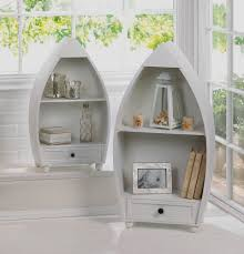 white boat shaped shelves in a beach coastal living room artenzo