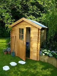 cabane jardin abri de jardin bois pvc toit plat côté maison