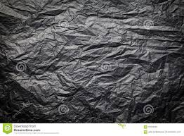 the dark texture of crumpled paper black background stock photo