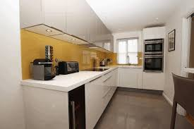 white bell l shade l shaped kitchen designs photos double built in oven yellow stained