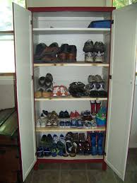 Tall Shoe Cabinet With Doors by White Tiered Hanging Garage Shoe Storage Behind The Door Decofurnish