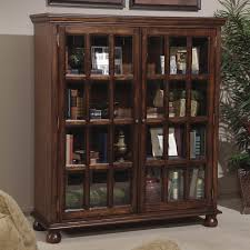 Wooden Bookcase With Glass Doors Brown Wooden Bookshelf With Glass Sliding Doors And