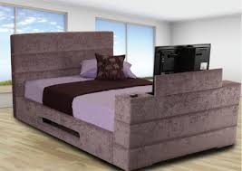 Bed Frame With Tv In Footboard Griffin Upholstered Tv Bed Frame Upholstered Beds Beds