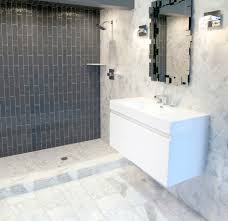bathroom ideas blue subway tile with two small windows grey subway tile bathroom large mirror above wall mounted vanity also two sconces